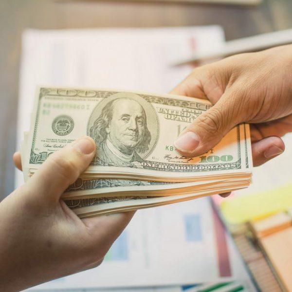 Handling hundred dollar bills